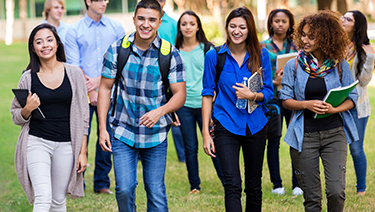 Group of young students walking outside
