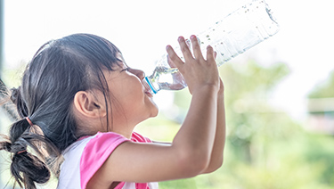 Girl drinking water.
