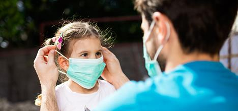 Neurologist: COVID-19 Masks Are a Crime Against Humanity and Child Abuse Father-applying-PPE